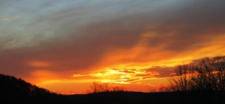 Vivid gold orange sunset in hills