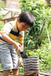 little boy in garden