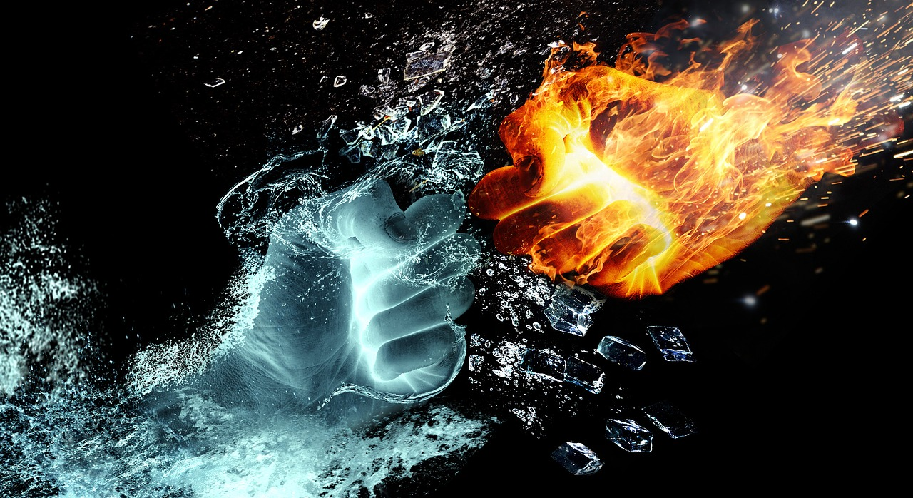 Fist of water fighting a fist of fire
