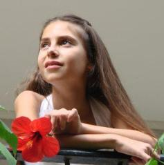 young girl with hibiscus