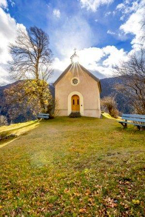 Blue sky with white puffy clouds over a rural church with autumn leaves in the fore band backgrounds