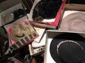 Boxes of hats, shoes, purses, furs, evening wear to get rid of