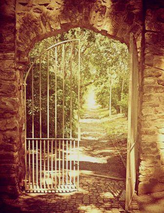 Open gate to illuminated pathway