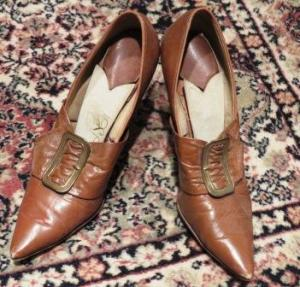 Very pointy brown ladies shoes with gold buckles