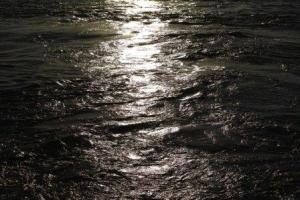Moonlight shining on swirling night sea