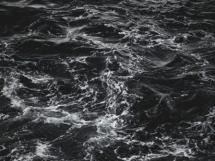 Black foamy sea churning