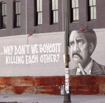 "Street art depicting a black man with the commentary ""...Why don't we boycott killing each other?"""