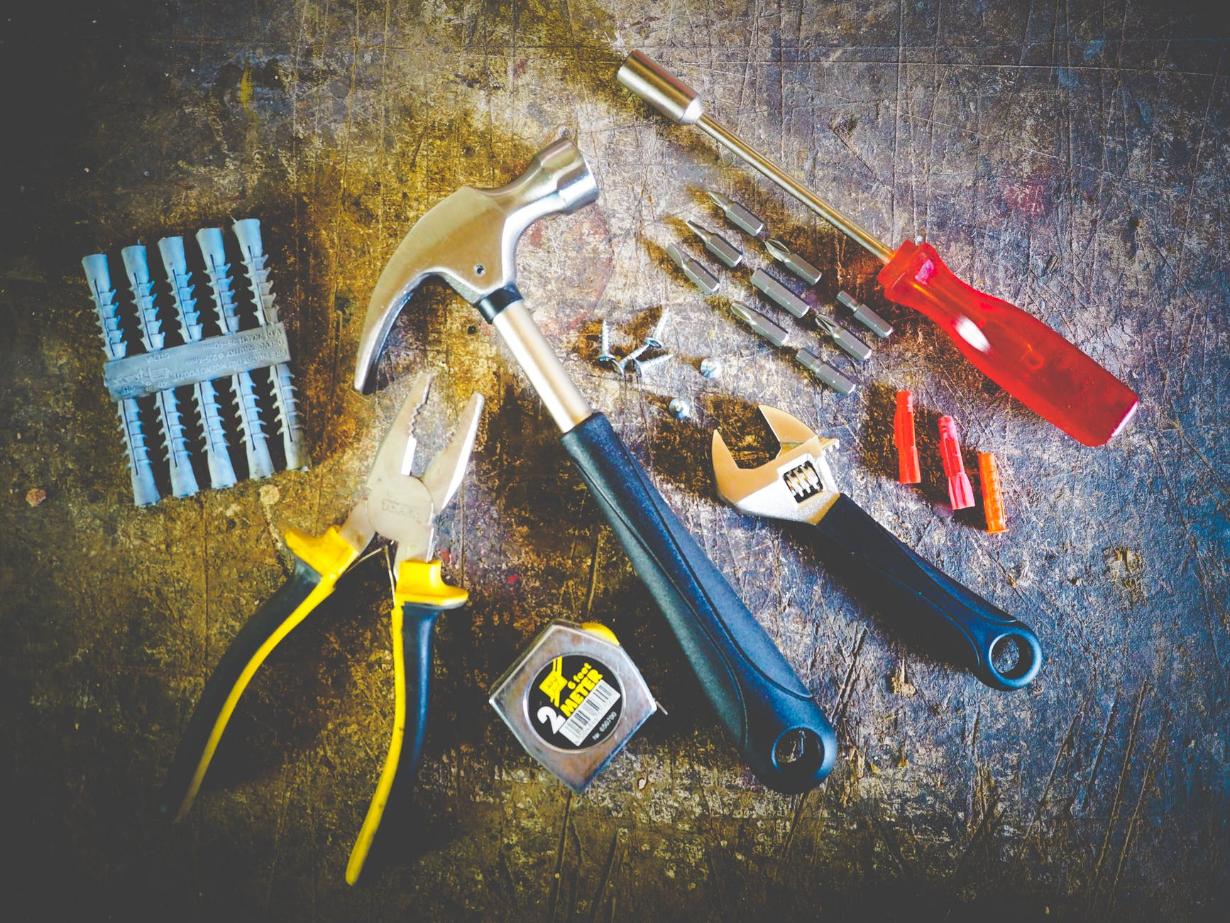 Photo of various types of tools such as hammer, measuring tape, wrench