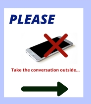 Sign indicating no cell phones and to talk outside