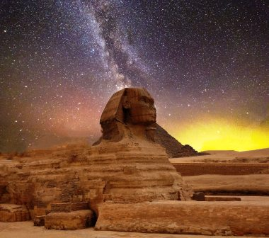 The Great Sphinx against a backdrop of stars and rising sun