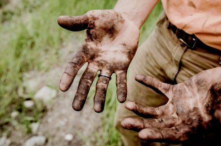 Wedding ring on dirty hands
