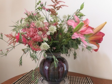 Bouquet of pink and magenta lilies with pink hydrangea and astilbe