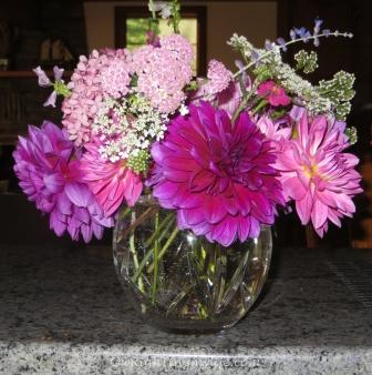 Bouquet of bright pink dahlias, pink and white yarrow, light purple lavendar