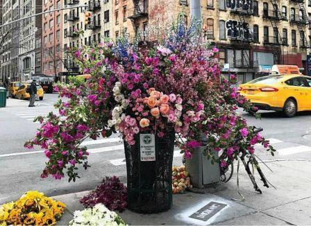 Enormous bouquet of colorful blooms in New York City trash can and sidewalk created by Lewis Miller Design