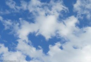 Blue sky with heart-shaped cloud