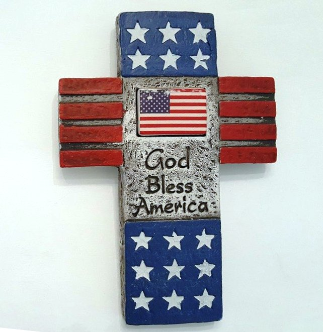 Stone cross of stars and stripes with inset of the American Flag and God Bless America
