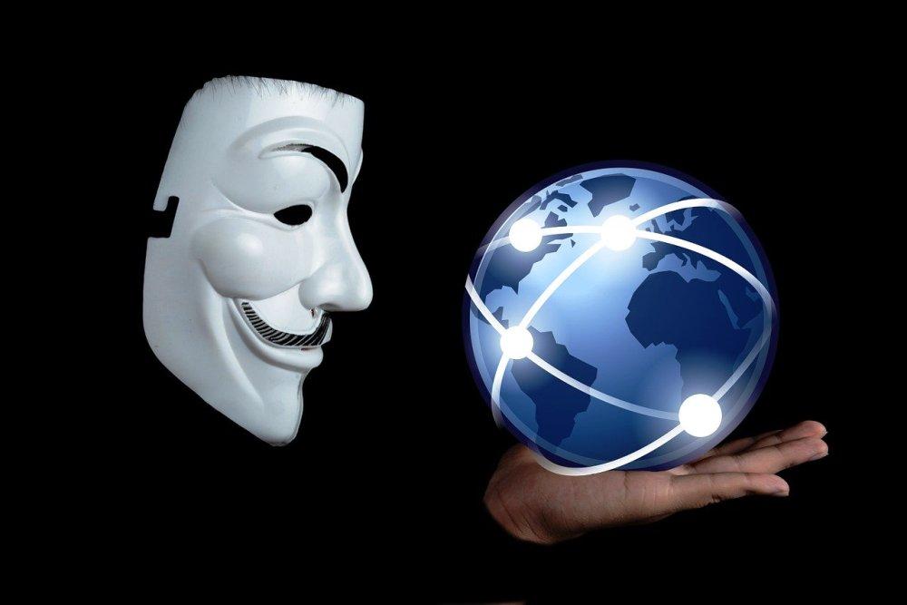 Mask holding a blue globe
