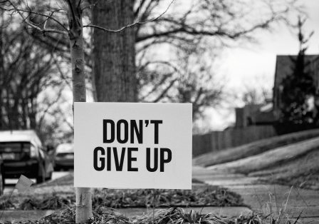 "Sign in rural America indicating ""Don't Give Up"""