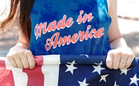 "Girl with tee shirt indicating ""made in America"" while holding American Flag"
