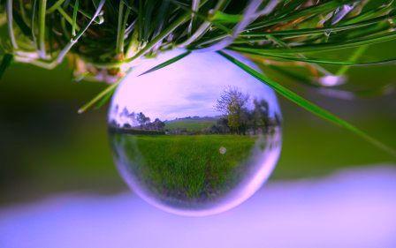 Globe with illuminated serene right side up landcape