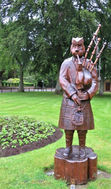 Brown Bagpiper Carving in Scotland