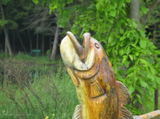 yellow wooden fish scupture