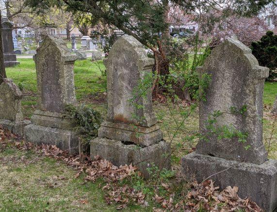 4 weathered cemetery headstones
