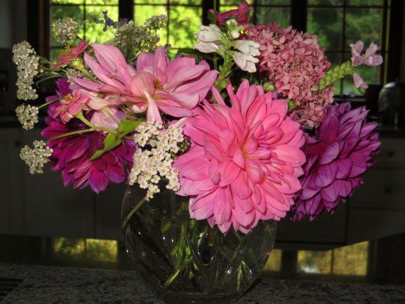 Bright pink dahlia and hydrangea flower arrangement