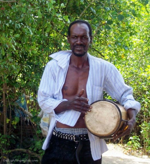Jamaican man playing hand drum