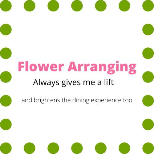 "Sign indicating ""Flower Arranging always gives me a lift and brightens the dining experience too"""