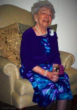Older woman in purple sitting on chair