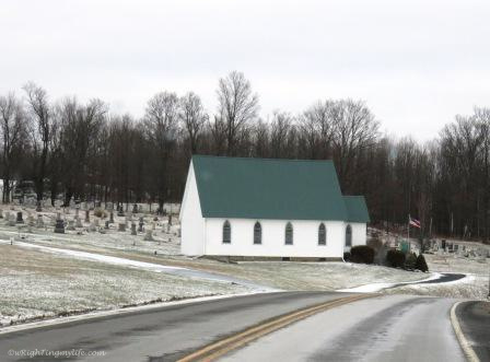 Church in snow dusted countryside