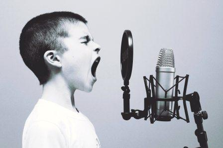 person screaming into microphone