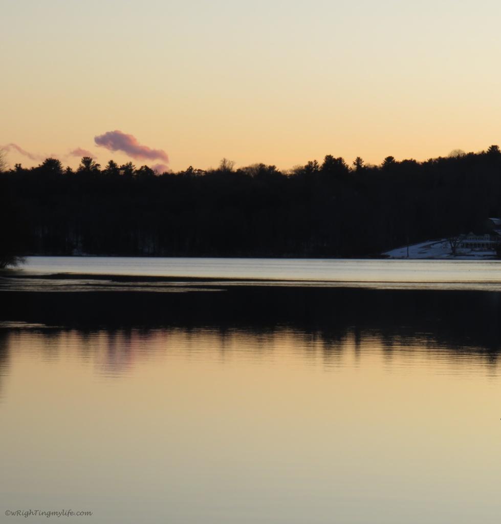 golden sky reflected in water