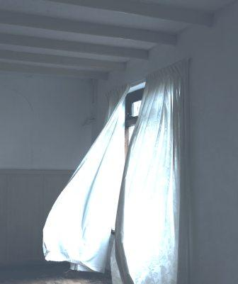 curtain blowing in open room