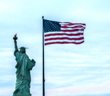 Statute of Liberty and American flag